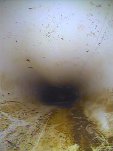 Pipe camera image or deformed and crushed stormwater pipe